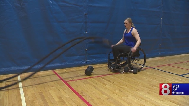 News story still shot of woman in wheelchair using ropes to workout at Chapter 126